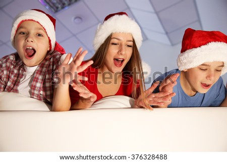 Cheerful children on sofa in decorated Christmas room, close up