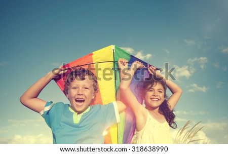 Cheerful Children Playing Kite Outdoors Friendship Concept - stock photo