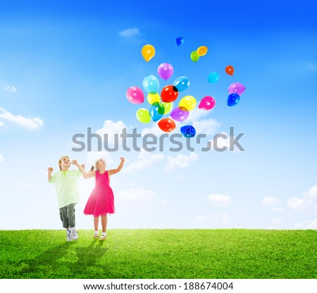 Cheerful Children Playing With Balloons Outdoors