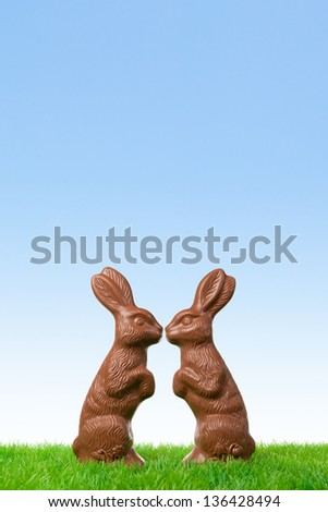 Cheerful chocolate easter bunnies in love. - stock photo