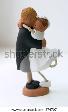 Cheerful clay figures of a newly-married couple - stock photo