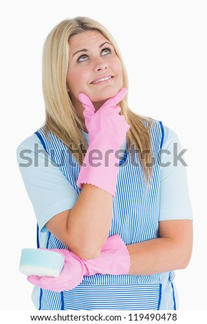 Cheerful cleaner thinking in the white background - stock photo
