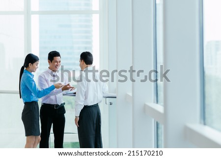 Cheerful colleagues discussing document - stock photo