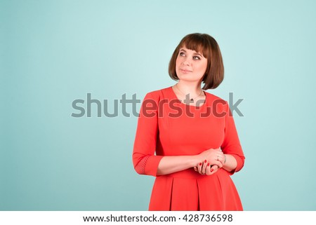 Cheerful confident business woman isolated over turquoise background with copyspace for your text - stock photo