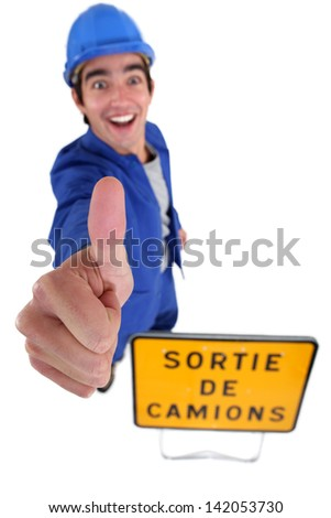 Cheerful construction worker with thumb up - stock photo