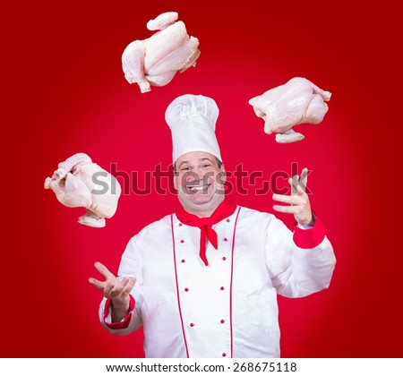 cheerful cook juggle with chickens - stock photo