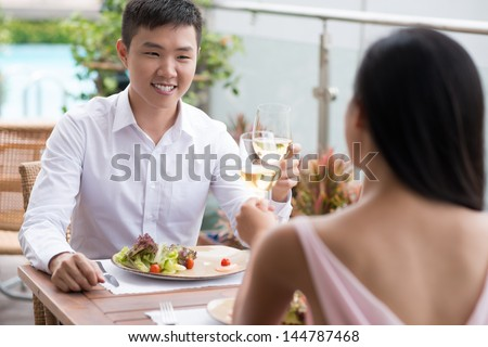 Cheerful couple enjoying a delicious lunch in a restaurant - stock photo
