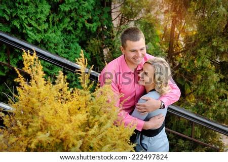 Cheerful couple having fun on summer vacation - stock photo