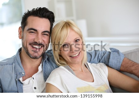 Cheerful couple having fun together - stock photo