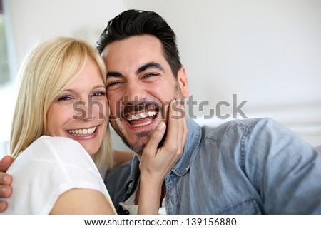 Cheerful couple having fun together - stock photo