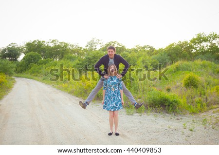 Cheerful couple in love walking in the summer forest. Love. Forest. Summer. Relations. Fun. Couple in love. A family.