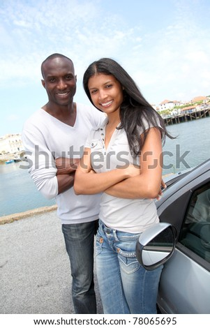 Cheerful couple in travel journey - stock photo