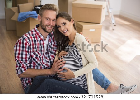 Cheerful couple in very advanced pregnancy