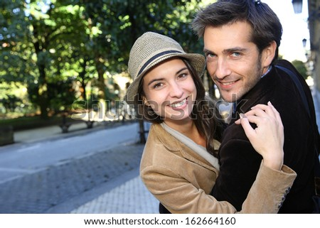 Cheerful couple on a shopping day in town - stock photo