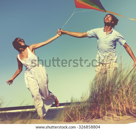 Cheerful Couple Playing Kite Beach Relaxing Remote Concept - stock photo