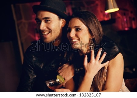 Cheerful couple together at the club enjoying the nightlife