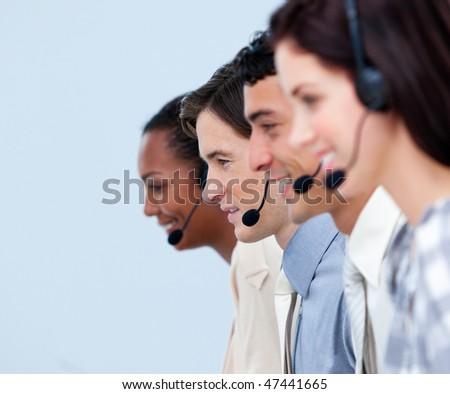 Cheerful customer service representatives in a call center - stock photo