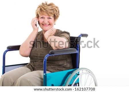 cheerful disabled senior woman talking on cell phone on white background - stock photo