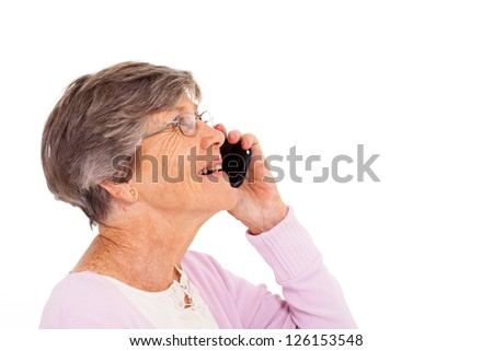 cheerful elderly lady talking on smart phone isolated on white - stock photo