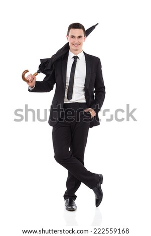 Cheerful elegance man holding an umbrella on his shoulder. Full length studio shot isolated on white. - stock photo