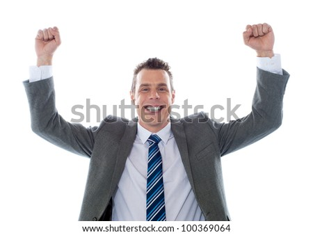 Cheerful excited business executive posing with arms up isolated over white - stock photo