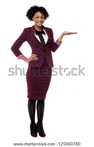 Cheerful executive presenting copy space with open palm. All on white background.