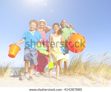 Cheerful Family Bonding by the Beach Concept - stock photo