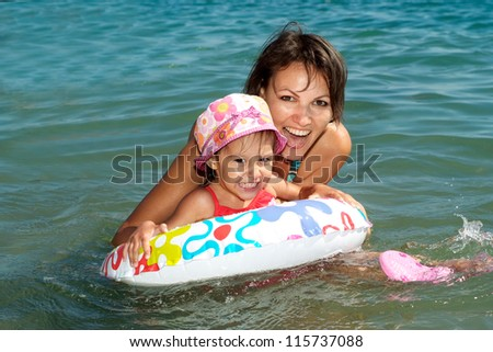 Cheerful family came to the beach to relax sea - stock photo