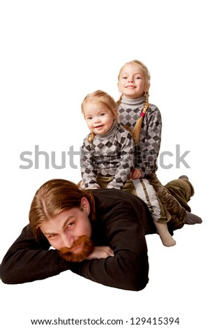 Cheerful family. Father and two children. Daughters sitting on the back of their father. Isolated on white background - stock photo