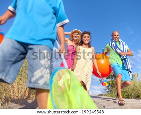 Cheerful Family Going to the Beach - stock photo