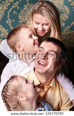 Cheerful family having fun - stock photo