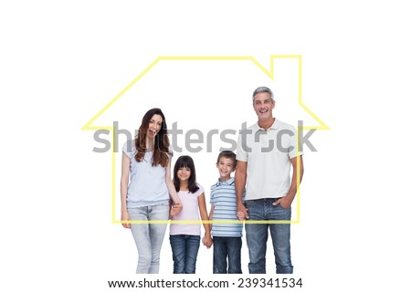 Cheerful family holding hands against house outline