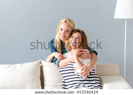 Cheerful family hugging with love - stock photo