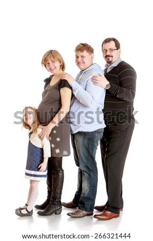 Cheerful family mom dad brother and a little sister.- isolated on white background - stock photo