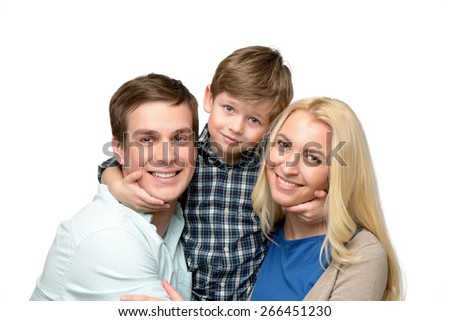 Cheerful family of three enjoying time together. Little boy hugging his parents. Isolated on white background. Concept for happy family - stock photo