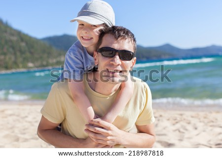 cheerful family of two having fun during vacation at lake tahoe, california, usa - stock photo