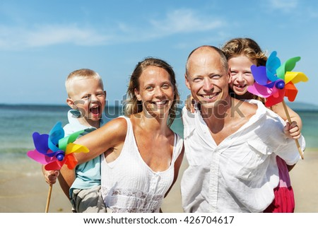Cheerful Family Playing by the Beach Concept