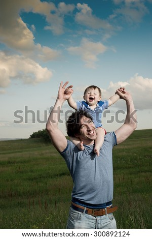 Cheerful family spends her time in nature - stock photo