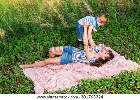 Cheerful family spends her time in nature
