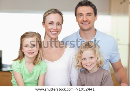 Cheerful family together in the kitchen - stock photo