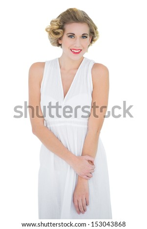 Cheerful fashion blonde model looking at camera on white background - stock photo