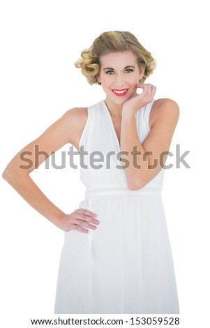 Cheerful fashion blonde model posing with a hand on the hip on white background - stock photo