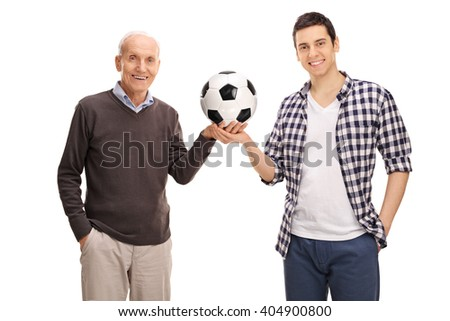 Cheerful father and son posing with a football isolated on white background