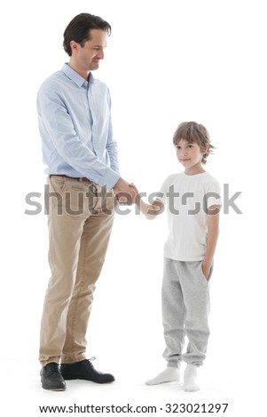 Cheerful father and son shaking hands isolated on white background