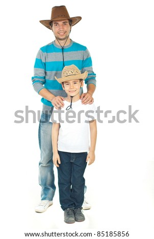 Cheerful father and son wearing cowboy's hat isolated on white background - stock photo