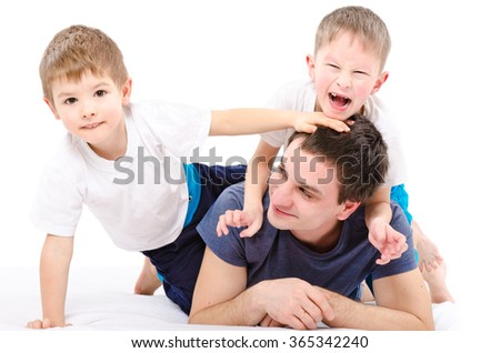 Cheerful father and sons isolated on a white background - stock photo