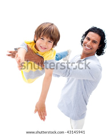 Cheerful father having fun with his son against a white background