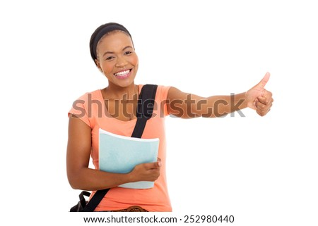 cheerful female african college student giving thumb up - stock photo
