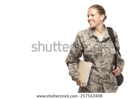 Cheerful female airman with books and bag and looking away - stock photo