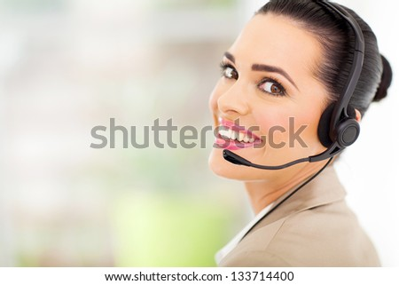 cheerful female call center telemarketer with headset - stock photo